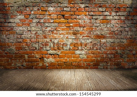 room interior vintage with red brick wall and wood floor background - stock photo