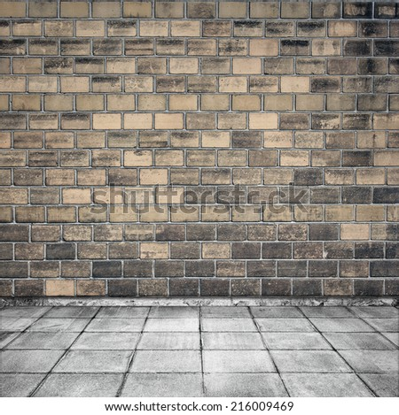 Room interior with brick wall and tiled floor - stock photo