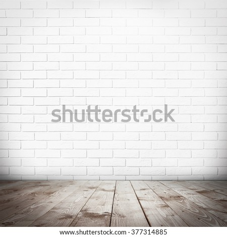 Room interior with brick wall and wooden floor - stock photo
