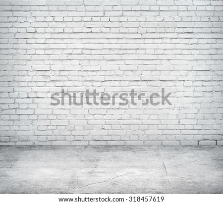 Room interior with white brick wall and concrete floor