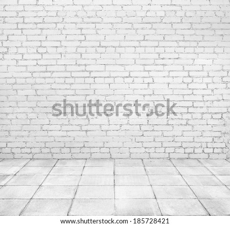 Room interior with white brick wall and tiled floor - stock photo