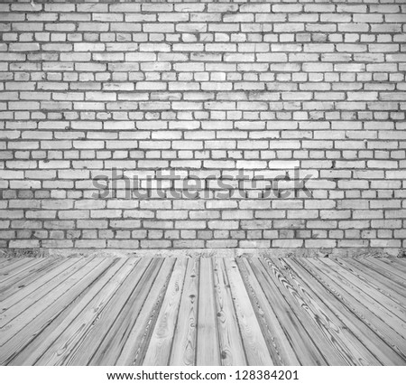 Room interior with white brick wall and wooden floor - stock photo