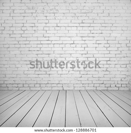 Room interior with white brick wall and wooden floor painted in white - stock photo