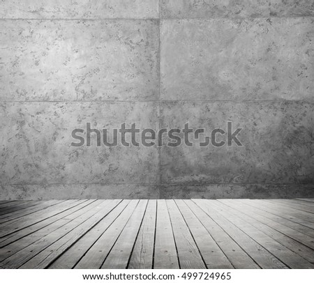 room interior with wooden floor and cement wall