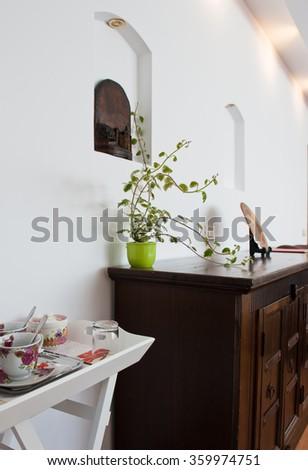 Room interior with wooden furniture - stock photo