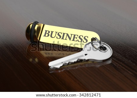 Room key with golden keychain business concept on the wooden background - stock photo