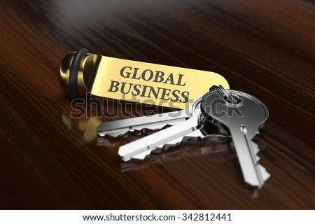 Room key with golden keychain global business concept on the wooden background - stock photo