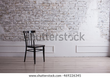 ROOM minimalism, background STONE WALL, MODERN ROOM. DECORATIVE BRICK WALL WHITE AND BLACK CHAIR CHAIR. Modern living Room, light background. Living Room, brick Wall