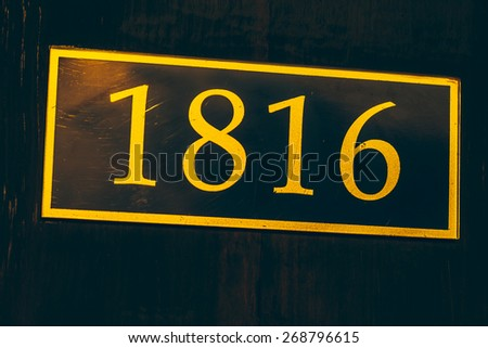Room number sign at door - vintage filter - stock photo