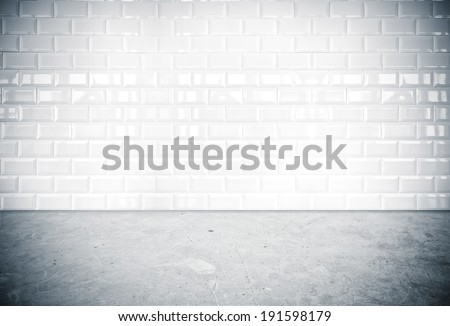 Room perspective,white ceramic tile wall and cement ground - stock photo