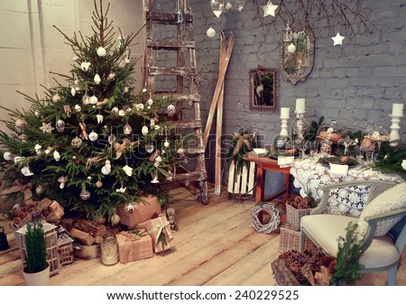 room with a green Christmas tree with beautiful toys and gifts under it - stock photo