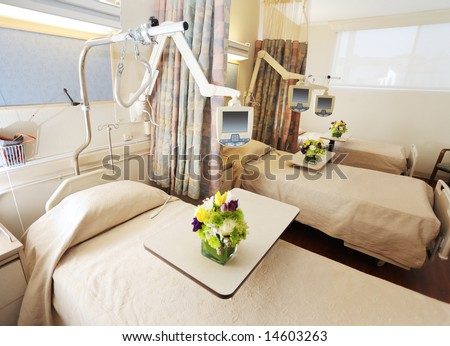 Room with beds in hospital - stock photo