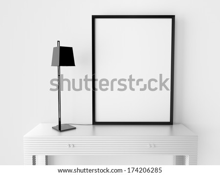 room with blank  frame on table - stock photo
