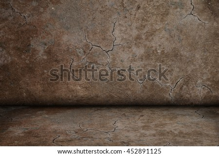 room with dark brown cracked and structured wall texture