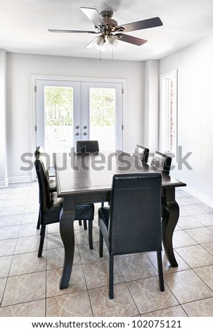 Room with dining table and chairs in upscale home