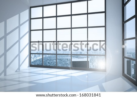 Room with large windows showing city