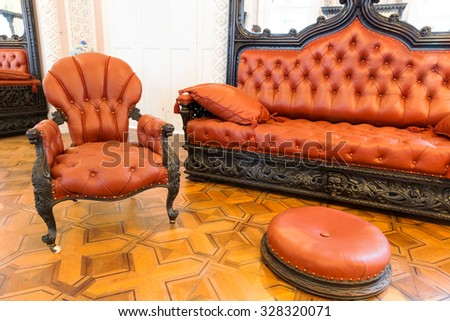 Room with luxurious vintage leather-covered furniture - stock photo