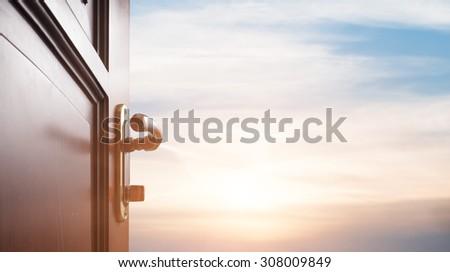 room with open door - stock photo
