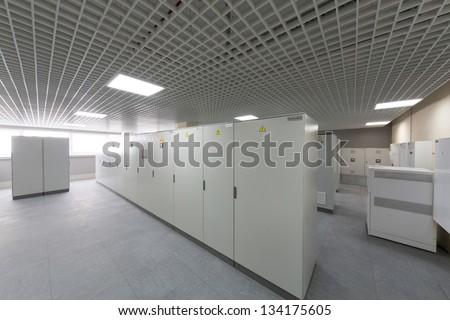 Room with rows of racks with equipment for telecom. - stock photo
