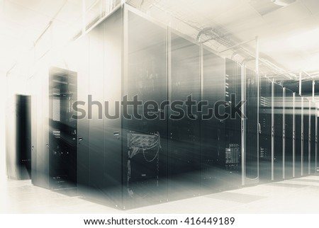 room with rows of server hardware in data center - stock photo