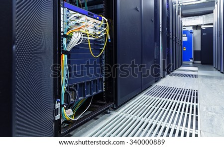 room with rows of server hardware in the data center - stock photo