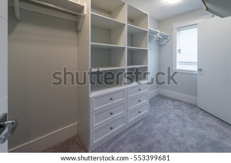 Captivating Room With The Open Empty Closet, Working Closet, Cupboard With Some Racks,  Hangers