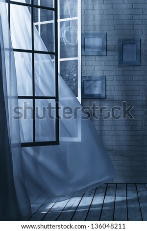 Room with the window open and the breeze on a moonlit night