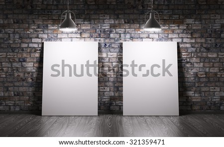 Room with two posters and lamps over the brick wall - stock photo