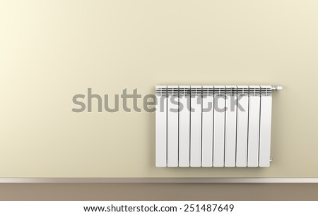 Room with warm colors and heating radiator attached on wall - stock photo