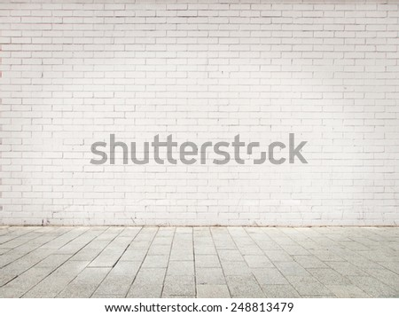 room with white bricks wall and gray floor - stock photo
