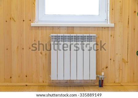 Room with window and radiator - stock photo