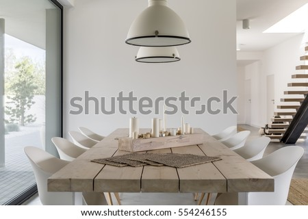 Room With Wood Dining Table White Chairs And Industrial Lamp