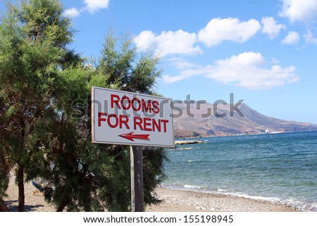 rooms for rent sign on beautiful beach - stock photo