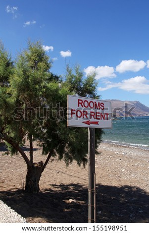 rooms for rent sign on the beach in Crete, Greek - stock photo