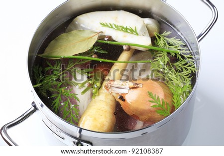 Root vegetables and beef meat in a pot
