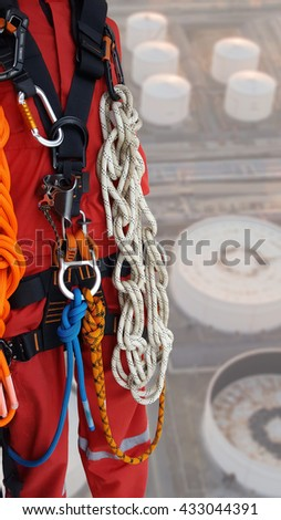 Rope access equipments on stroge tank background