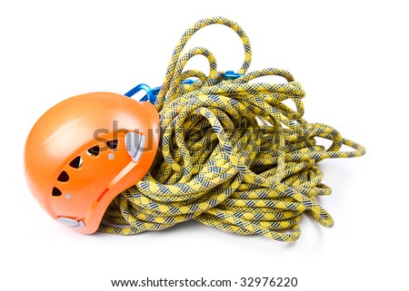 Rope access tools: hard hat, rope, carabiner - stock photo