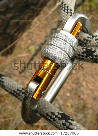 Rope and Carbine for mountaineering - stock photo
