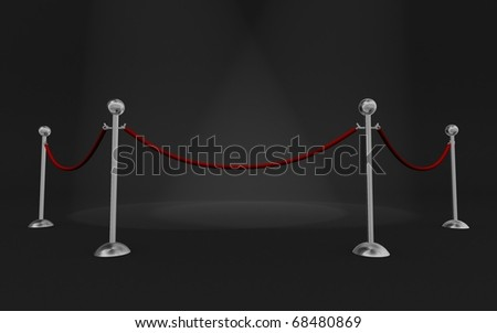 Rope barrier in a dark scene with scene lights - stock photo