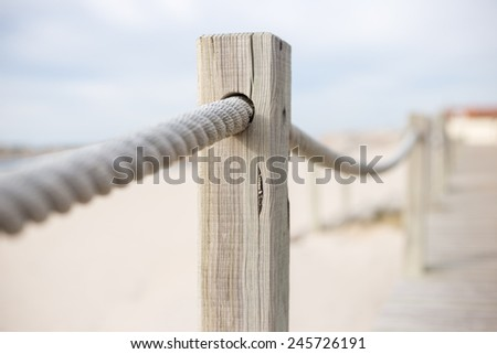 Rope barrier on beach with selective focus