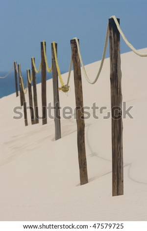 Rope barrier on sand - stock photo
