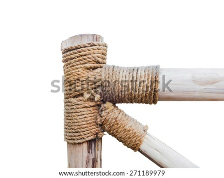 rope circle on the pole, tied rope on the pole, isolated, handrail wood - stock photo