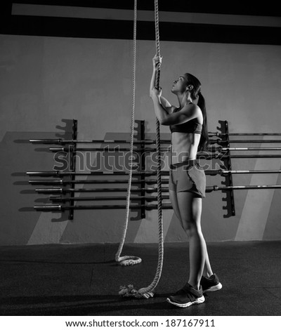 Rope Climb exercise woman workout at gym climbing - stock photo