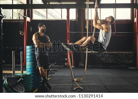 rope climbing exercise sportsman his trainer stock photo royalty