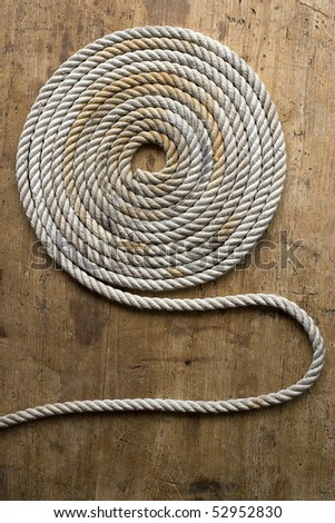 Rope coil on an antique chest - stock photo