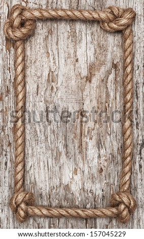 rope frame and old wood background