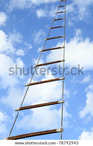Rope ladder to the sky background - stock photo