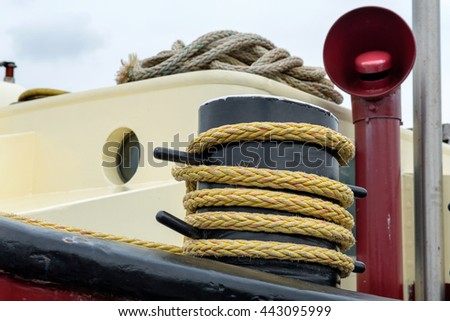 Rope on a bollard on a ship anchored in the port of Amsterdam, The Netherlands - stock photo