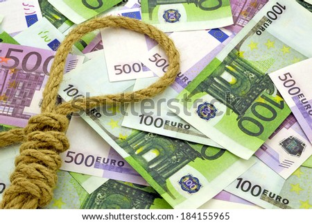 Rope on money background/ Photo a thick loops of rope on the background of euro money