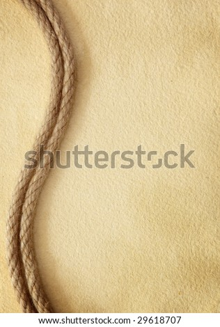 Rope on old paper - stock photo